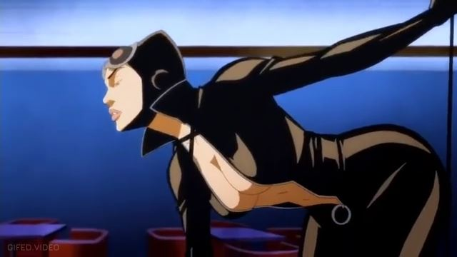 The Cat woman unzips the suit, flashing her boobs, and whips with her whip.