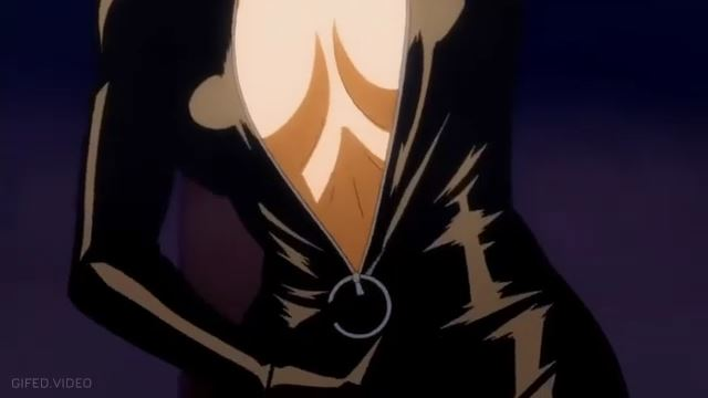 The Cat woman unzips her suit, flashing her big tits, a hot striptease scene.
